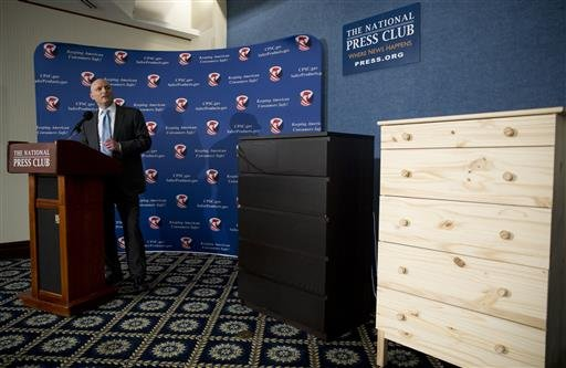 With two Ikea dressers displayed at right, Consumer Product Safety Commission (CPSC) Chairman Elliot Kaye speaks during a news conference at the National Press Club in Washington, Tuesday, June 28, 2016.