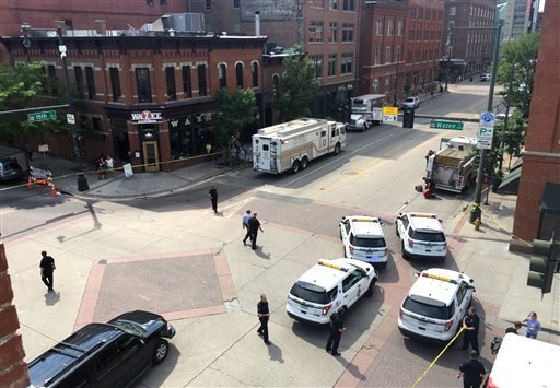 Police respond to reports of a shooting in Denver, Tuesday, June 28, 2016. Police say a gunman walked into a busy downtown Denver office building and shot multiple times before turning the gun on himself. (Eric Lutzens/The Denver Post via AP)