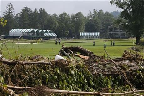 Workers survey debris along the 17th fairway and begin the cleanup of the Old White Course on the property of the Greenbrier Resort in White Sulphur Springs, W. Va., Tuesday, June 28, 2016.