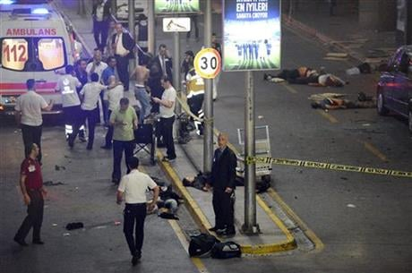 GRAPHIC CONTENT Medics and security members work at the entrance of the Ataturk Airport after explosions in Istanbul, Tuesday, June 28, 2016.