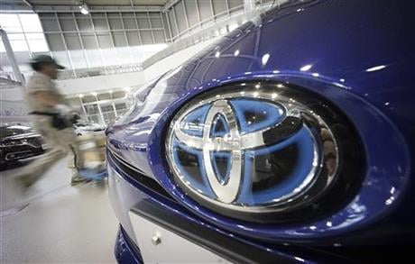 Toyota is recalling 1.43 million vehicles globally for defective air bags that aren't part of the massive recalls of Takata air bags, the Japanese automaker said Wednesday. (AP Photo/Eugene Hoshiko)
