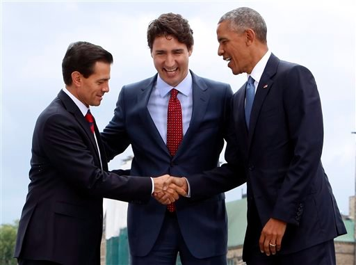 Mexico President Enrique Pena Nieto, left, Canada Prime Minister Justin Trudeau, center, and President Barack Obama pose for a photo at the North American Leaders Summit at the National Gallery of Canada in Ottawa, Wednesday, June 29, 2016.