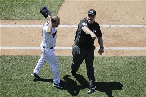 First base umpire Bill Miller, right, ejects San Diego Padres manager Andy Green, left, as he complains about a call during the fifth inning of a baseball game Wednesday, June 29, 2016, in San Diego. (AP Photo/Gregory Bull)