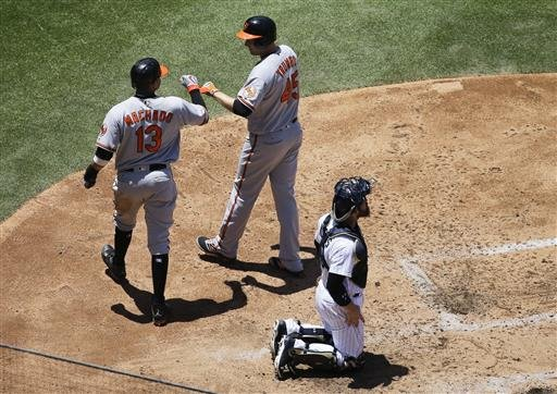 Baltimore Orioles' Mark Trumbo (45) is greeted by teammate Manny Machado (13) after hitting a two-run home run during the fourth inning of a baseball game as San Diego Padres catcher Derek Norris looks on at right Wednesday, June 29, 2016, in San Diego. (