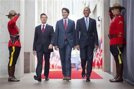 President Barack Obama walks with Canadian Prime Minister Justin Trudeau and Mexican President Enrique Pena Neito at the National Gallery of Canada in Ottawa, Canada, Wednesday, June 29, 2016. Obama traveled to Ottawa for the North America Leaders' Summit