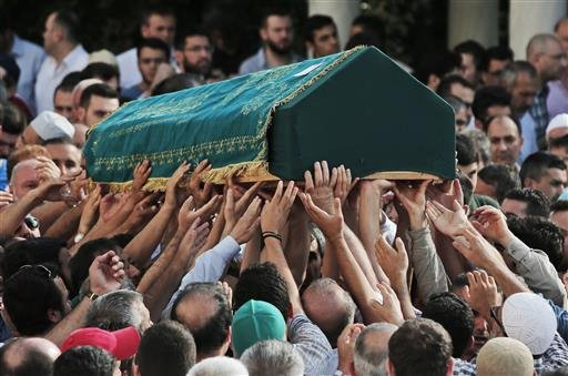 Mourners carry the coffin of Muhammed Eymen Demirci, killed Tuesday at the blasts in Istanbul's Ataturk airport, during the funeral in Istanbul's Basaksehir neighbourhood, Wednesday, June 29, 2016.