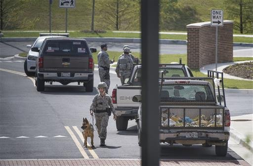 Security personnel patrol outside the Malcolm Grow Medical facility on Andrews AFB in Morningside, Md., when the base was placed on lockdown about 9 a.m. after an active shooter was reported, Thursday, June 30, 2016.