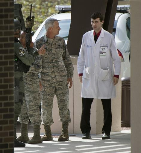Medical personnel are escorted out of the Malcolm Grow Medical facility on Andrews AFB in Morningside, Md., when the base wasplaced on lockdown about 9 a.m. after an active shooter was reported, Thursday, June 30, 2016.