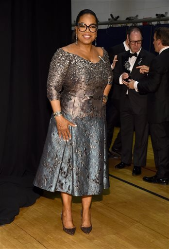 """Oprah Winfrey, winner of the award for best revival of a musical for """"The Color Purple,"""" poses in the press room at the Tony Awards on Sunday, June 12, 2016, in New York. (Photo by Charles Sykes/Invision/AP)"""