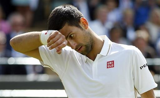 Novak Djokovic of Serbia wipes his face during his men's singles match against Sam Querrey of the U.S on day six of the Wimbledon Tennis Championships in London, Saturday, July 2, 2016.