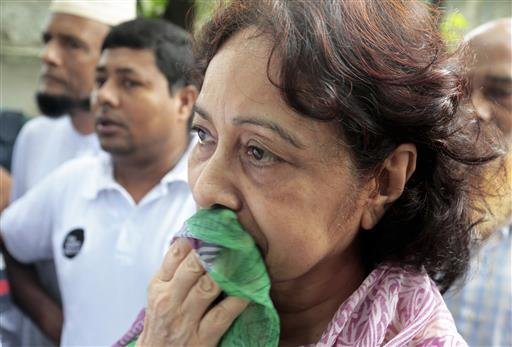 Hosne Ara Karim, whose son and daughter-in-law were rescued from the restaurant that was attacked by heavily armed militants, wait for them in Dhaka, Bangladesh, Saturday, July 2, 2016.