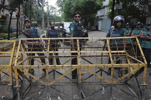 Bangladeshi policemen stand guard at a barricade leading to Holey Artisan Bakery in Dhaka's Gulshan area, Bangladesh, Sunday, July 3, 2016. The assault on the restaurant in Dhaka's diplomatic zone by militants who took dozens of people hostage marks an es