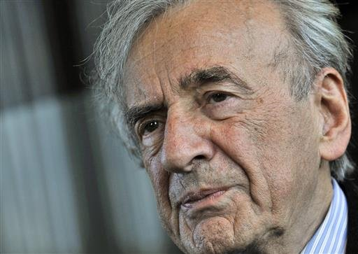 In this Dec. 10, 2009 file photo, Elie Wiesel listens during an interview with The Associated Press in Budapest, Hungary. Wiesel, the Nobel laureate and Holocaust survivor has died. His death was announced Saturday, July 2, 2016 by Israel's Yad Vashem Ho