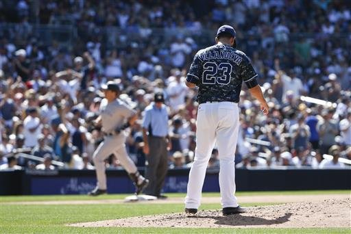 San Diego Padres relief pitcher Carlos Villanueva stands on the mound as he watches New York Yankees' Mark Teixeira round the bases with his 400th career home run in the eighth inning of a baseball game, Sunday, July 3, 2016, in San Diego. (AP Photo/Lenny