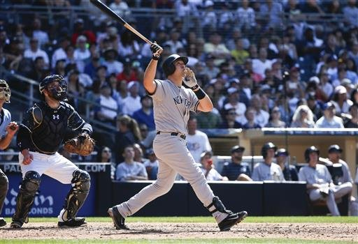 New York Yankees' Mark Teixeira drives a home run down the right field against the San Diego Padres in the eighth inning of a baseball game, Sunday, July 3, 2016, in San Diego. It was Teixeira's 400th career home run. The San Diego catcher is Derek Norris
