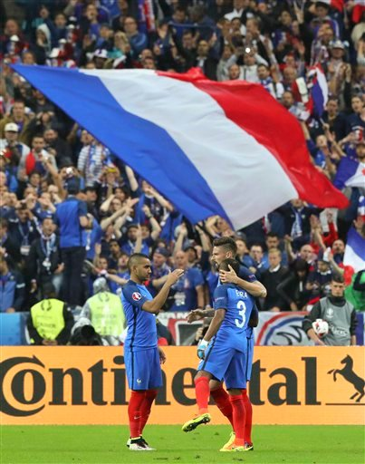 France's Olivier Giroud, right, celebrates with Patrice Evra and Dimitri Payet, left, after scoring his side's fifth goal during the Euro 2016 quarterfinal soccer match between France and Iceland, at the Stade de France in Saint-Denis, north of Paris, Fra