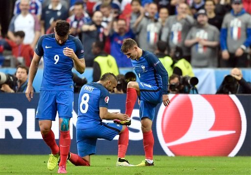 France's Antoine Griezmann, right, celebrates with Dimitri Payet after scoring his side's fourth goal during the Euro 2016 quarterfinal soccer match between France and Iceland, at the Stade de France in Saint-Denis, north of Paris, France, Sunday, July 3,