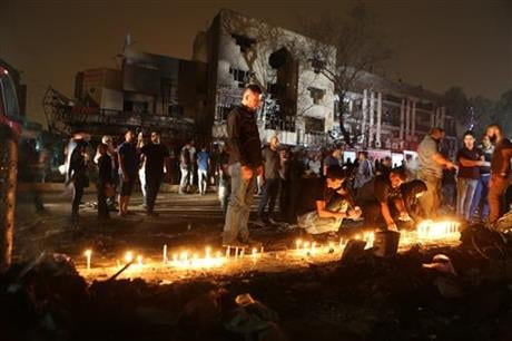 More than 100 people died Sunday in a car bombing that Islamic State said it carried out, an official of the Iraqi Interior Ministry said. (AP Photo/Hadi Mizban)