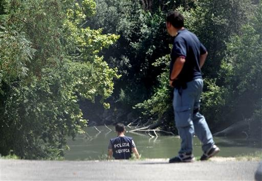 Italian Police inspect the banks of the Tiber river in Rome where the body of a young man was found, Monday, July 4, 2016.