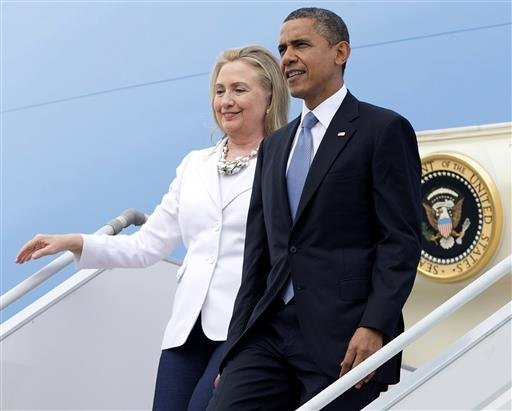 FILE - In this Nov. 19, 2012, file photo, President Barack Obama and then-Secretary of State Hillary Clinton arrive at Yangon International Airport.