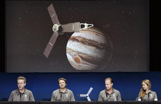 Michael Watkins, right, Scott Bolton, center, and Jim Green react in Mission Control at NASA's Jet Propulsion Laboratory as the solar-powered Juno spacecraft goes into orbit around Jupiter on Monday July 4, 2016 in Pasadena, Calif. (AP Photo/Ringo H.W. Ch