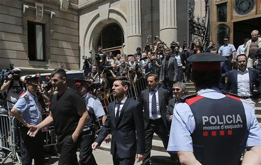 In this June 2, 2016 file photo, Barcelona soccer player Lionel Messi, center, leaves a court in Barcelona, Spain, Thursday, June 2, 2016.