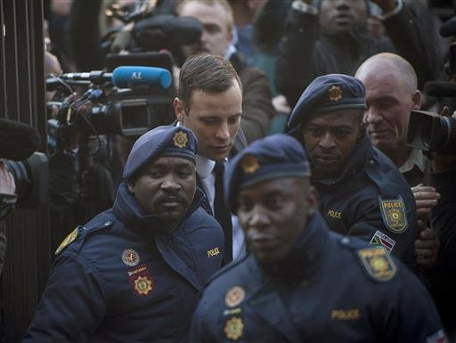 Oscar Pistorius, second from left, arrives at the High Court in Pretoria, South Africa Wednesday, July 6, 2016.