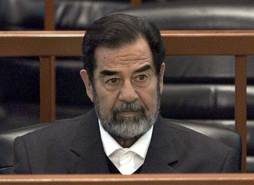"In this Dec. 6, 2006 file photo, former Iraq leader Saddam Hussein sits in court in Baghdad, Iraq, during the ""Anfal"" trial against him."
