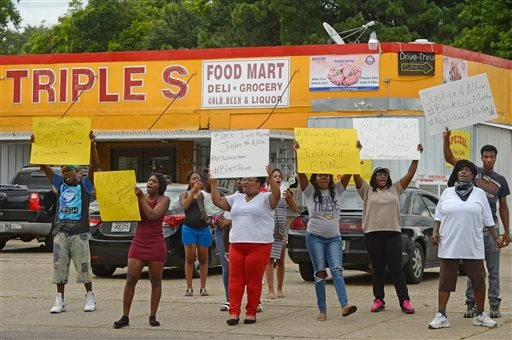 Family and friends of Alton Sterling protest on the corner of Fairfields Ave. and North Foster Drive Tuesday afternoon, July 5, 2016, after was fatally shot in an altercation with Baton Rouge Police just after midnight, in the parking lot of the Triple S