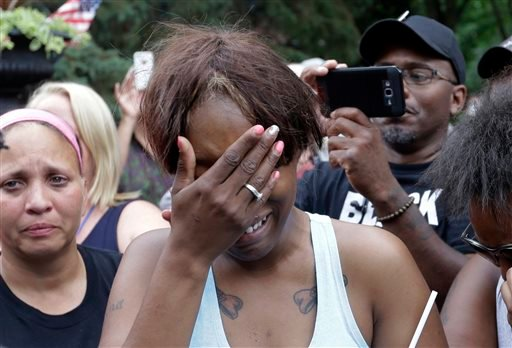 Diamond Reynolds, the girlfriend of Philando Castile of St. Paul, cries outside the governor's residence in St. Paul, Minn., on Thursday, July 7, 2016.