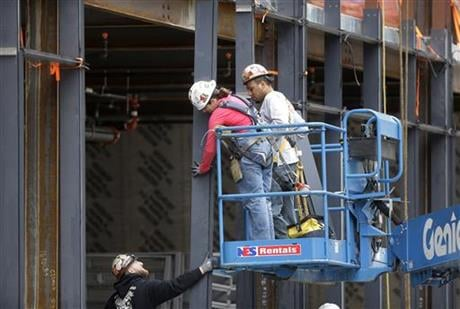 In this Thursday, May 19, 2016, photo, workers construct a building in Boston. On Friday, July 8, the U.S. government issues the June jobs report. (AP Photo/Steven Senne)