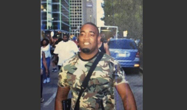 "ughes told a television station that he was ""defamed"" by the Dallas Police Department, which tweeted the photo of him and described him as a suspect in the shootings of police officers. Hughes turned himself in to police. AP"