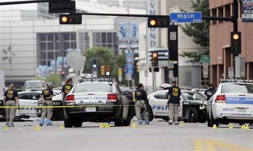 Investigators work in the area of downtown Dallas that remains an active crime scene, Saturday, July 9, 2016. Micah Johnson, an Army veteran, opened fire on police officers in the heart of Dallas Thursday. (AP Photo/Eric Gay)