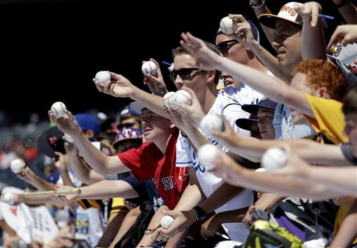 Fans ask for autographs during batting practice at the MLB baseball All-Star Game, Tuesday, July 12, 2016, in San Diego. (AP Photo/Gregory Bull)