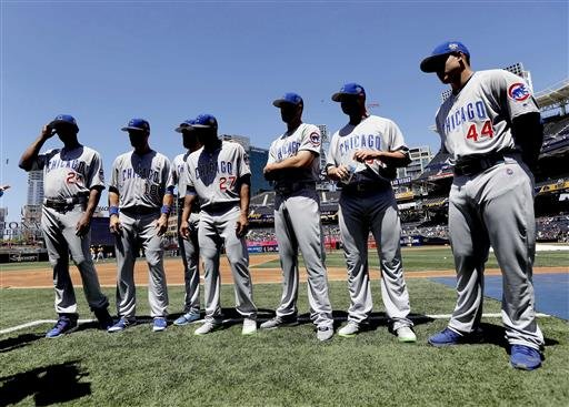 The Chicago Cubs' National League All Stars, from left, Dexter Fowler, Ben Zobrist, Jake Arrieta, Addison Russell, Kris Bryant, Jon Lester, and Anthony Rizzo pose the field during batting practice at the MLB baseball All-Star game, Tuesday, July 12, 2016,