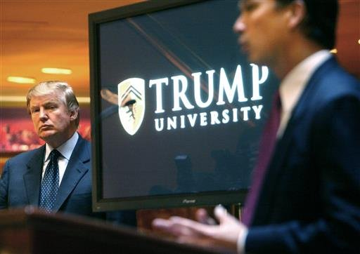 In this May 23, 2005 file photo, real estate mogul and Reality TV star Donald Trump, left, listens as Michael Sexton introduces him at a news conference in New York.