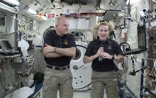 In this image made from video provided by NASA, astronaut Kate Rubins, right, speaks during an interview aboard the International Space Station on Wednesday, July 13, 2016.