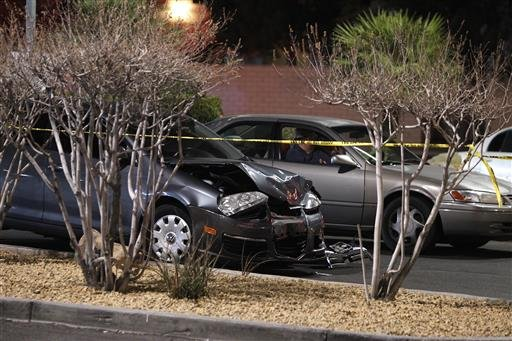 In this Jan. 21, 2014 file photo, a damaged car is seen at the scene of a fatal road rage incident near the corner of Tropicana Avenue and Rainbow Boulevard in Las Vegas.