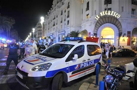 """A spokesman for France's Interior Ministry says there are likely to be """"several dozen dead"""" after a truck drove into a crowd of revelers celebrating Bastille Day in the French city of Nice. (AP Photo/Christian Alminana)"""