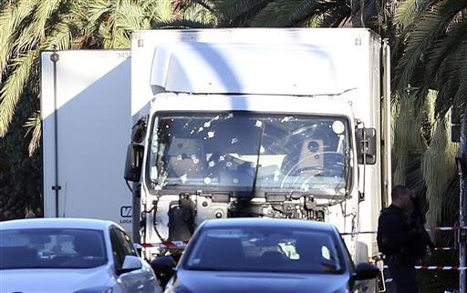 The truck which slammed into revelers late Thursday, July 14, is seen near the site of an attack in the French resort city of Nice, southern France, Friday, July 15, 2016.