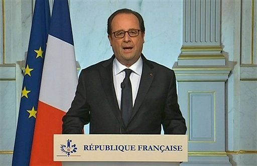 French President Francois Hollande makes a televised address in Paris early Friday July 15, 2016