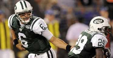 New York Jets quarterback Mark Sanchez hands off to running back Leon Washington during the first quarter of a preseason NFL football game against the Baltimore Ravens on Monday, Aug. 24, 2009, in Baltimore. (AP Photo/Nick Wass)