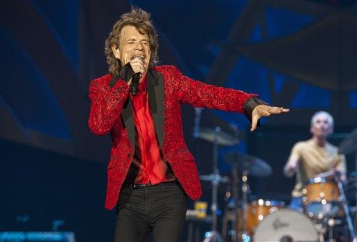 In this July 4, 2015 file photo, Mick Jagger of the Rolling Stones performs at the Indianapolis Motor Speedway in Indianapolis, Ind.