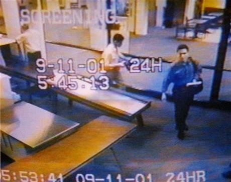 In this Sept. 11, 2001 file photo from airport surveillance tape released Sept. 19, 2001, two men, identified by authorities as suspected hijackers Mohamed Atta, right, and Abdulaziz Alomari, center, pass through airport security at Portland International