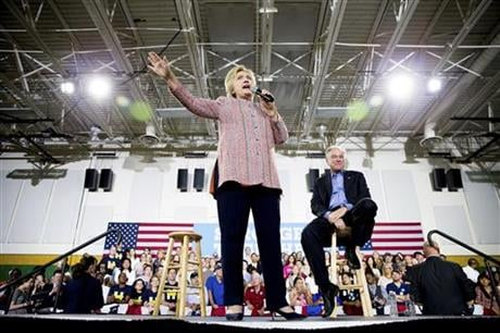 Democratic presidential candidate Hillary Clinton, accompanied by Sen. Tim Kaine, D-Va., right, speaks at a rally at Northern Virginia Community College in Annandale, Thursday, July 14, 2016. Kaine has been rumored to be one of Clinton's possible vice pre