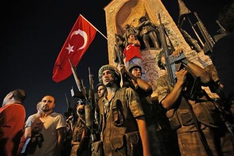 A loud explosion was heard in the capital, Ankara, fighter jets buzzed overhead, gunfire erupted outside military headquarters and vehicles blocked two major bridges in Istanbul. (AP Photo/Emrah Gurel)