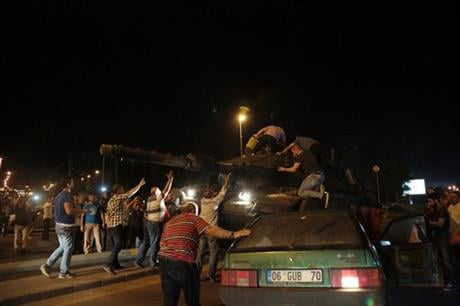 "Tanks move into position as Turkish people attempt to stop them, in Ankara, Turkey, late Friday, July 15, 2016. Turkey's armed forces said it ""fully seized control"" of the country Friday and its president responded by calling on Turks to take to the stree"