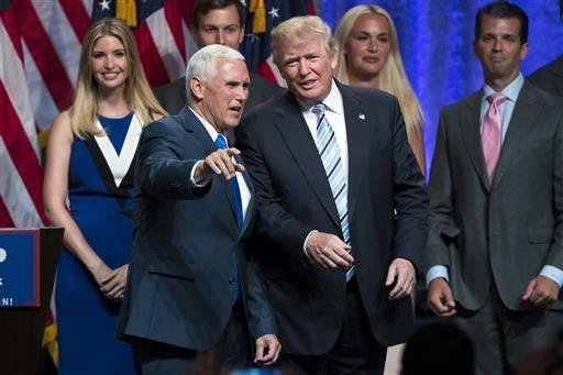 Republican presidential candidate Donald Trump, right, talks with Gov. Mike Pence, R-Ind., during a campaign event to announce Pence as the vice presidential running mate.