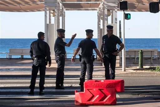 Riot police officers patrol on the Promenade des Anglais in Nice, southern France, Saturday, July 16, 2016.