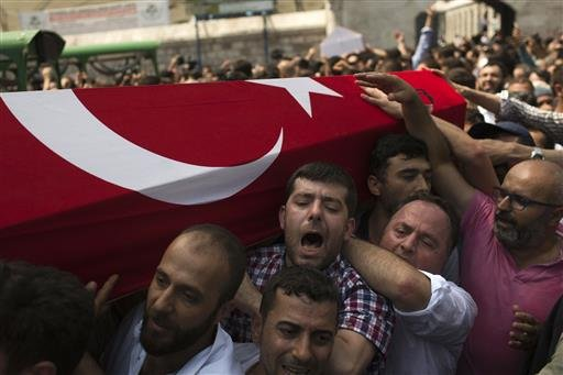 Mourners at a funeral carry the coffin of a person killed Friday while protesting against the attempted coup against Turkey's government, in Istanbul, Sunday, July 17, 2016.